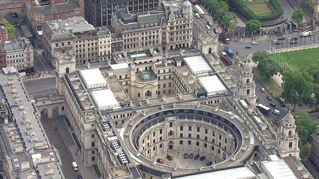 Shows exterior shots aerials HMRC Treasury building on Whitehall with circular courtyard in the middle Foreign Commonwealth building in the...