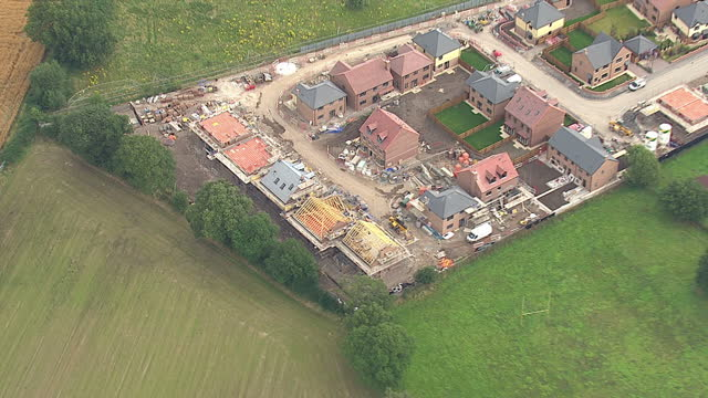 Shows exterior shots aerials new build construction site with houses in various stages of development on August 12 2015 in Unspecified England