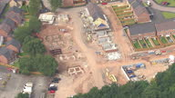 Shows exterior shots aerials new build housing construction site with buildings in various stages of construction on August 12 2015 in Unspecified...
