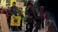 Shows Exterior shots AntiFracking protesters with posters and banners gathering and preparing for protest outside building where inquiry is taking...