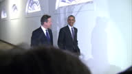 Shows exterior shots Barack Obama David Cameron walk along path to room of the White House past press taking pictures on January 16 2015 in...