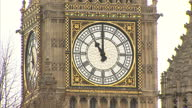 Shows Exterior Shots Big Ben clock tower face showing the hands moving from 1059 to 1102 on November 11 2015 in London England