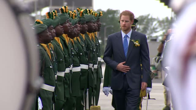Shows exterior shots Caribbean Military Guard of Honour welcoming Prince Harry to the island and Harry carrying out troop inspection Prince Harry is...