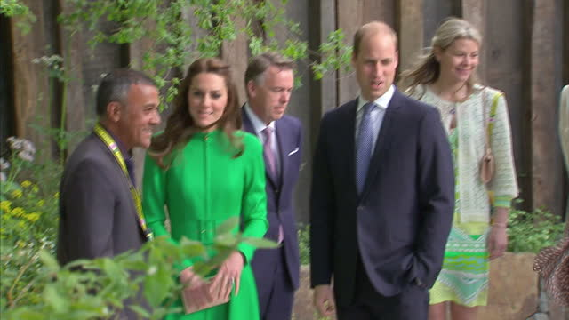 Shows exterior shots Catherine Duchess of Cambridge and Prince William Duke of Cambridge touring gardens and chatting to designers at Chelsea Flower...