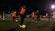 Shows exterior shots children practising football skills at youth scheme backed by Premier League and Tottenham Hotspur Football Club in order to...