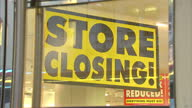 Shows exterior shots closed down BHS store near closed down Woolworths store Exterior and Interior shots posters and signs offering discounts in...