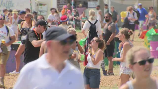 Shows exterior shots crowds arriving at Glastonbury Festival on 22nd June 2017 in Glastonbury Somerset England