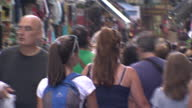 Shows exterior shots crowds of people in pedestrianised shopping area of Athens on June 28 2015 in Athens Greece