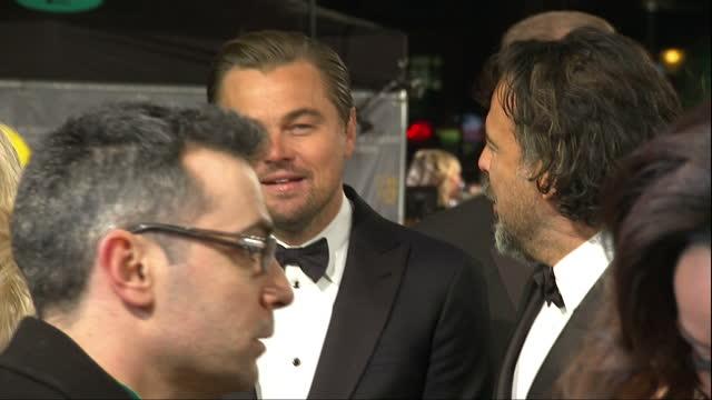 Shows Exterior shots director Alejandro Gonzalez Inarritu and actor Leonardo DiCaprio talking on red caarpet The 2016 BAFTAS Film Awards ceremony at...