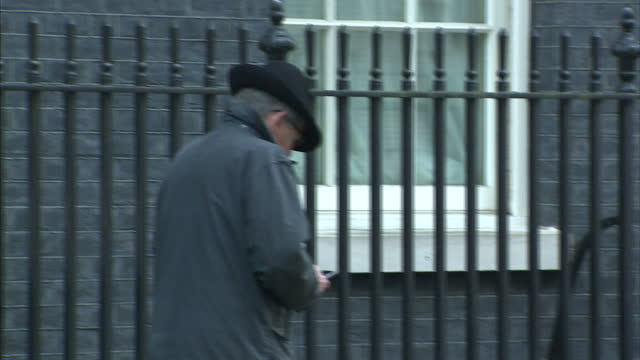 Shows exterior shots Don Foster departing 10 Downing St stopping to look at his phone on January 20 2015 in London England