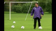 Shows exterior shots England Football Manager Graham Taylor laughing as he kicks ball during England team training session on October 9th 1993 in...