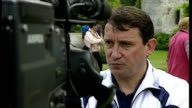 Shows exterior shots England Football Manager Graham Taylor talking to press giving interviews and posing for photo opportunity wearing England...