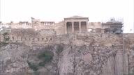 Shows exterior shots Erechtheion temple atop the Acropolis from the Monastiraki flea market on June 28 2015 in Athens Greece