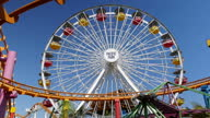 Shows exterior shots ferris wheel and roller coaster at Pacific Park Amusement park on Santa Monica Pier on 26th July 2017 in Santa Monica Beach...