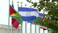 Shows exterior shots flags from various nations outside the UN Headquarters building on 18th September 2017 in New York USA