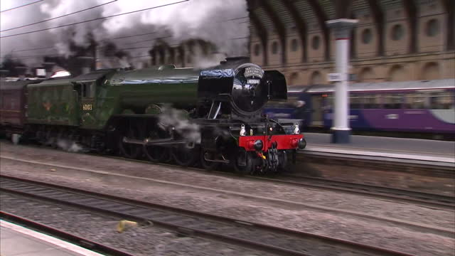 Shows exterior shots Flying Scotsman steam train moving through York Station A broken spring has cast doubt on whether the famous Flying Scotsman...