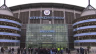 Shows exterior shots football fans arriving at Manchester City's Etihad Stadium to watch football match Exterior shots voxpops speaking on sex abuse...