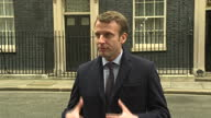 Shows exterior shots French Presidential Candidate Emmanuel Macron on a walkabout in Westminster London surrounded by press and taking selfies with...