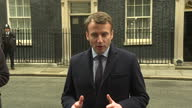 Shows exterior shots French Presidential Candidate Emmanuel Macron walking out of Number 10 Downing Street and walking over to waiting press and...