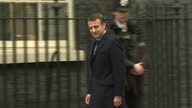 Shows exterior shots French Presidential Candidate Emmanuel Macron arriving at Number 10 Downing Street in London and answering questions shouted by...