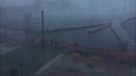 Shows exterior shots from hotel window in low light strong winds as Hurricane Maria arrives in San Juan with waves throwing water across the road and...