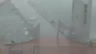 Shows exterior shots from hotel window strong winds as Hurricane Maria arrives in San Juan with waves throwing water across the road palm trees being...