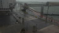 Shows exterior shots from third floor balcony strong winds blowing and rain falling over bay and road in San Juan as Hurricane Maria arrives...