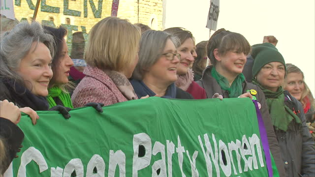 Shows exterior shots Green Party leader Natalie Bennett standing with demonstrators with Green Party women banner on January 19 2015 in London England