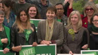 Shows exterior shots Green Party members and supporters including Green MP Caroline Lucas holding Green Party placards at UK 2017 Election Campaign...