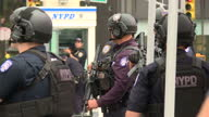 Shows exterior shots heavily armed NYPD police officers standing guard in area surrounding the United Nations Headquarters in New York during UN...