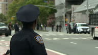 Shows exterior shots heavy security around the United Nationas Headquarters in New York with police officers directing pedestrians and controlling...