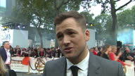 CLEAN Shows exterior shots interview with actor Taron Egerton speaking on making the film on the orange carpet at the World Premiere of 'Kingsman The...