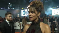 CLEAN Shows exterior shots interview with actress Halle Berry speakig on making the film on the orange carpet at the World Premiere of 'Kingsman The...