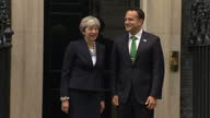 Shows exterior shots Irish Prime Minsiter Leo Varadkar arriving at Downing Street and posing for photocall on steps of Number 10 for handshake with...