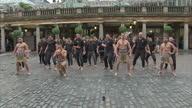 Shows Exterior shots Jonah Lomu performing a Ka Mate haka led by the Ngati Ranana London Maori Club in Covent Garden London ahead of 2015 Rugby World...