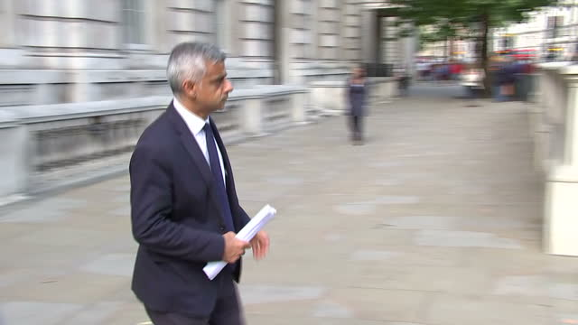 Shows exterior shots London Mayor Sadiq Khan and Met Police Assistant Commissioner Mark Rowley leaving the Cabinet Offices in Whitehall after an...
