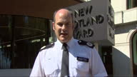 Shows exterior shots Metropolitan Police Commander at press conference speaking on missing from Grenfell Tower QUOTE 'Now that number 79 may change I...