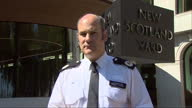 Shows exterior shots Metropolitan Police Commander Stuart Cundy at press conference speaking on 79 people confirmed dead from Grenfell Tower fire and...