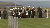 Shows exterior shots military marching bands arriving at Lyness World War I Cemetery on Hoy for Battle of Jutland Commemoration Ceremony including...