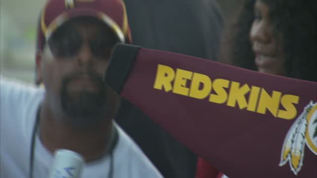 Shows exterior shots NFL Redskins fans having party in parking lot outside Fedex Field Stadium before match on 25th September 2017 in Washington DC...
