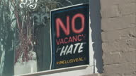 Shows exterior shots 'No vacancy for hate' poster in window and 'Everyone is Welcome' poster in window on 13th February 2017 in Alexandria Virginia...