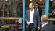 Shows exterior shots Paper Cup a cafe run by the charity Spitalfields Crypt Trust with security officer standing outside and Prince William and...