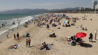 Shows exterior shots people having fun on Santa Monmica Beach on 26th July 2017 in California USA