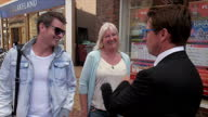 Shows exterior shots people walking about in Chelmsford Voxpops on voting in EU Referendum Exterior shots Conservative 'In' Campaigners talking to...