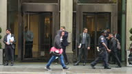 Shows exterior shots people walking out of revolving doors and standing talking in front of entrance to W New York Hotel on Lexigton Avenue in...