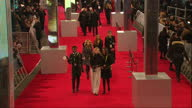 Shows Exterior shots people walking up and milling about on the red carpet Photographers taking photos of stars and BAFTA banners and posters The...