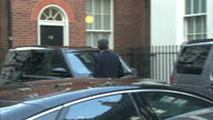 Shows exterior shots Philip Hammond departing 10 Downing St with red folder under his arm on January 20 2015 in London England