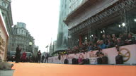 CLEAN Shows exterior shots photographers and cameramen waiting behind barriers to photo the stars arriving orange carpet at the World Premiere of...