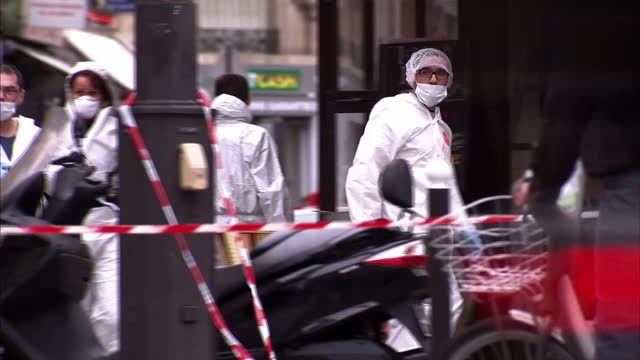 Shows Exterior shots police forensics team at crime scene location in investigation into attacks Exterior shots objects dropped on floor in aftermath...