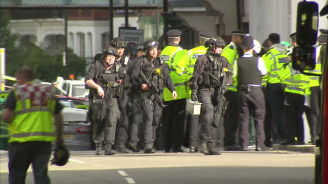Shows exterior shots police officers guarding taped off street outside property in SunburyonThames raided by police in Parsons Green Terror attack...